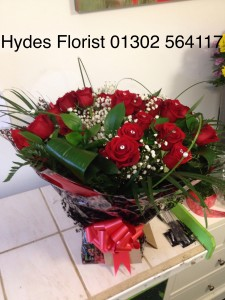 24 red roses hand tied bouquet £100