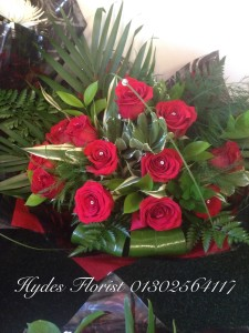 12 red roses hand tied bouquet £50