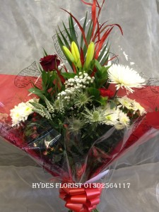 traditional valentines bouquet with single res rose £30