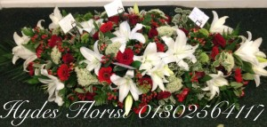red-roses-and-lilly-coffin-top