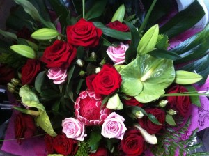 hand tied with red roses £45